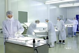 HRDC employees in a clean room