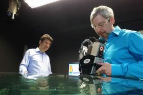 HRDC employees inspect a glass surface
